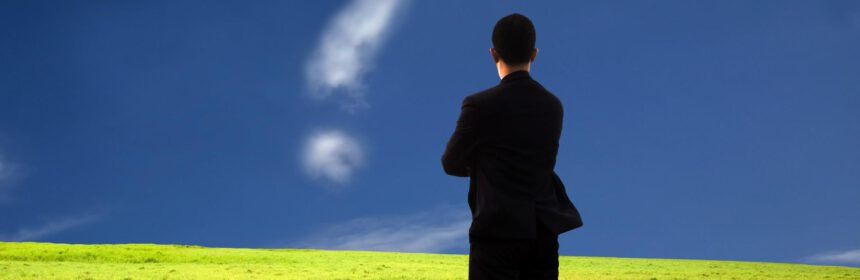 businessman thinking and watching the question mark.the  composition of the cloud